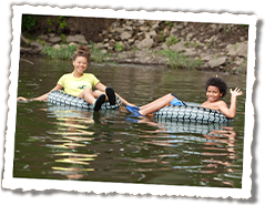 Two girls tubing on the river